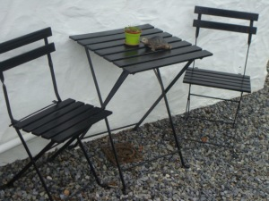 Our old Ikea patio set has come up a treat painted black!